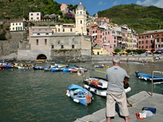 Angler looking at the church of Vernazza in the Cinque Terre